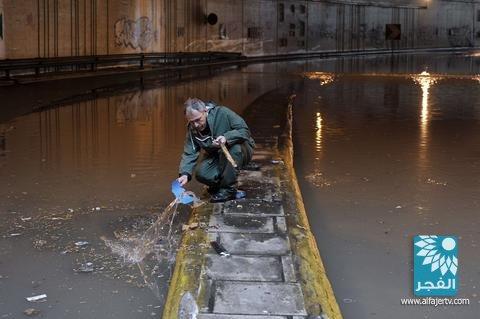 بالصور فيضانات الامطار الغزيره