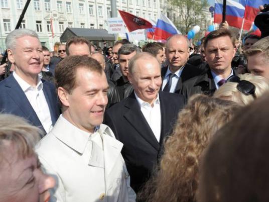 الرئيس الروسي فلاديمير بوتين الرئيس المنتهية ديمتري مدفيديف